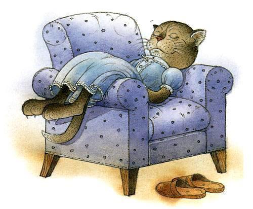 кошка спит на диване