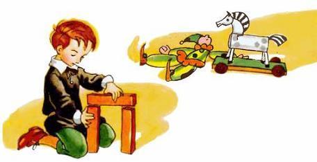 мальчик Миша ирает с игрушками