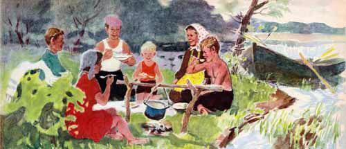 семья готовит уху на природе на берегу