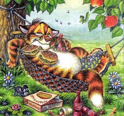 кот Пузик обьелся и лежит в гамаке