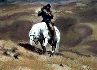 едет по пустыне на коне